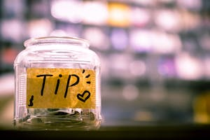 Tip jar on a bar counter