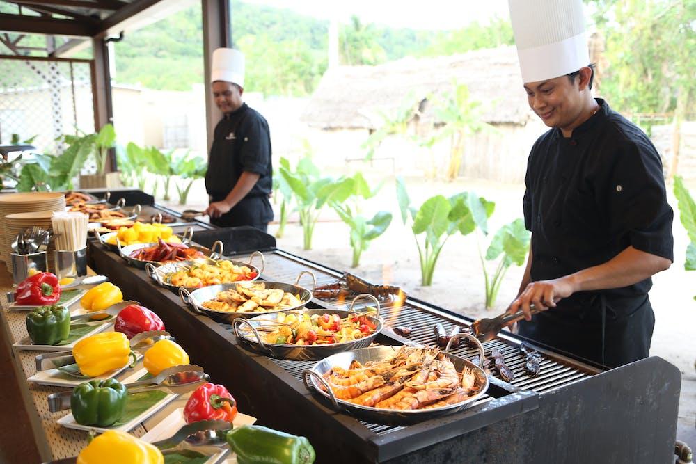 Cooks preparing delicious food in Tumon, Guam