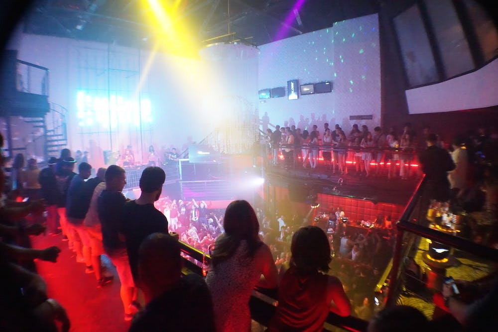 people crowded around the dance floor at The Globe nightclub in Tumon, Guam
