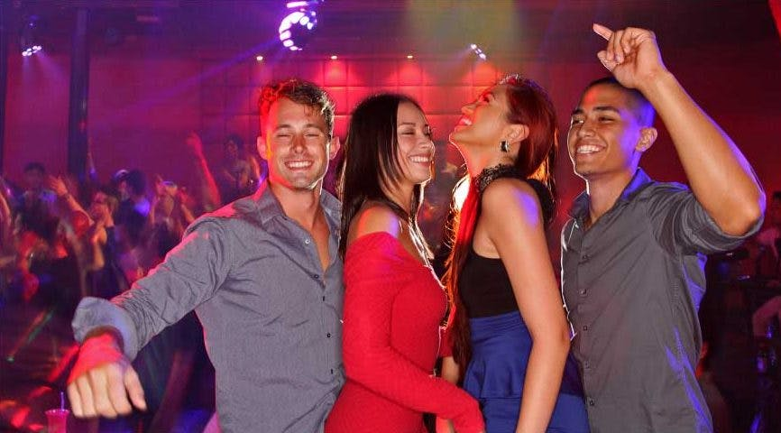 Four people partying in the Globe nightclub in Tumon, Guam