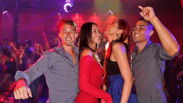 Four people partying in the Globe nightclub in Tumon, Guam