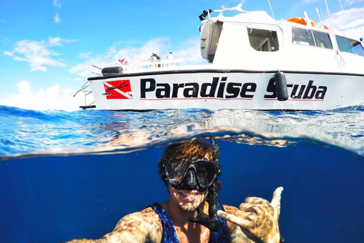 A diver taking a selfie with one of the vessels