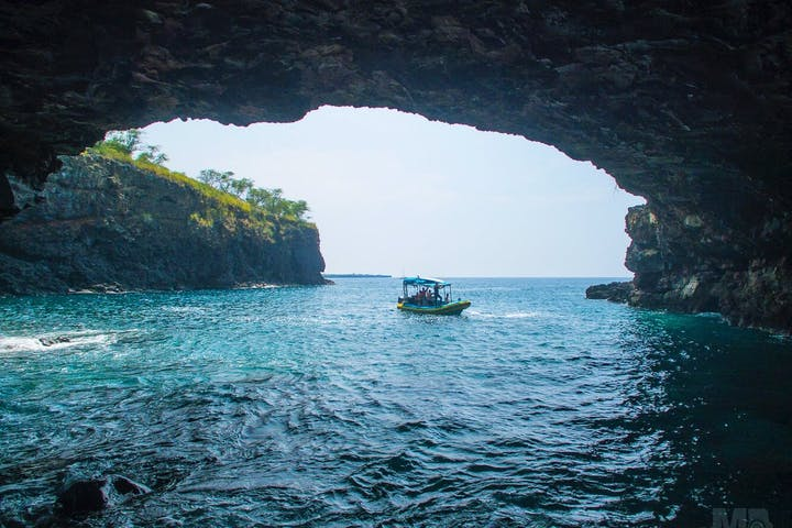One of the boats as seen from the mouth of a cave