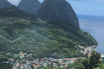 a view of a large body of water with Pitons in the background