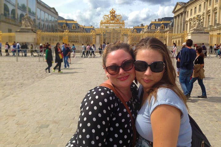 Two women in an open courtyard