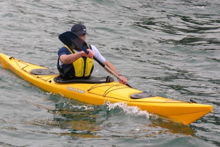 1ec22faecfdf Kayaker paddling on a river tour