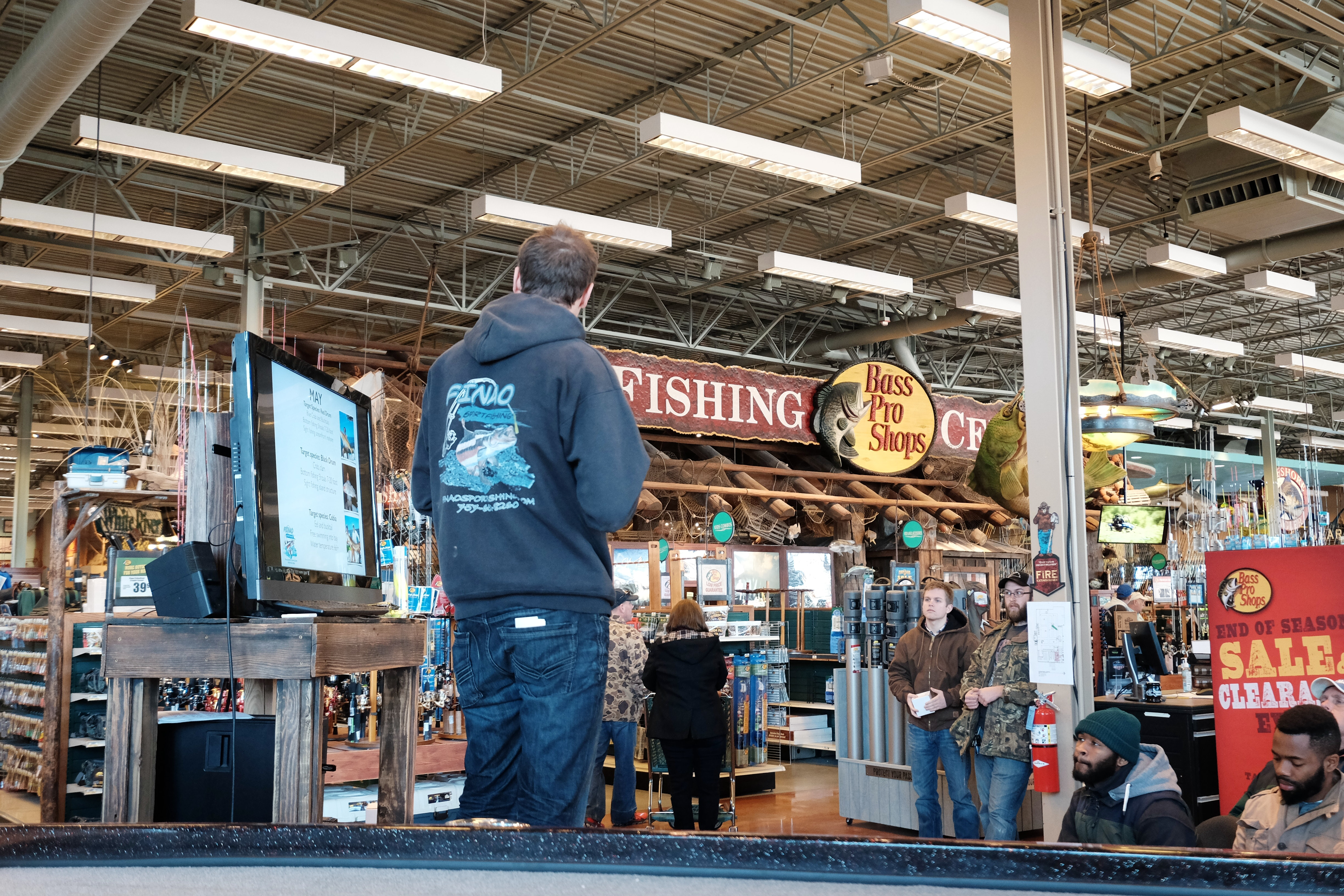 An audience listens to Austin Hayne's fishing presentation