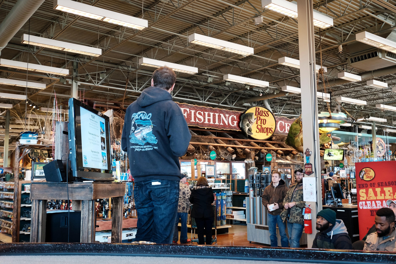 An audience listens to Austin Hayne's fishing presentation