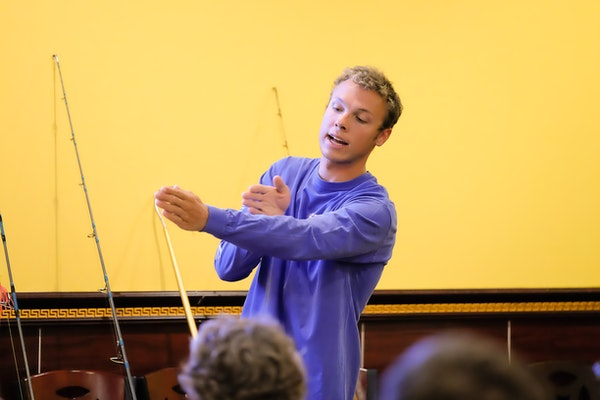 A young man instructing at a fishing seminar