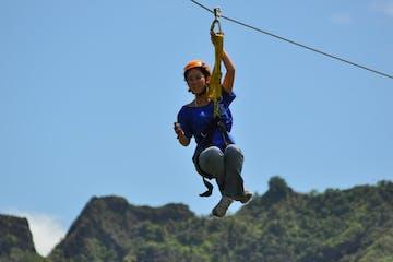 Wikiwiki Zip Tour girl in front of Kauai mountains