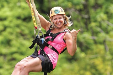 Woman on a zipline giving the