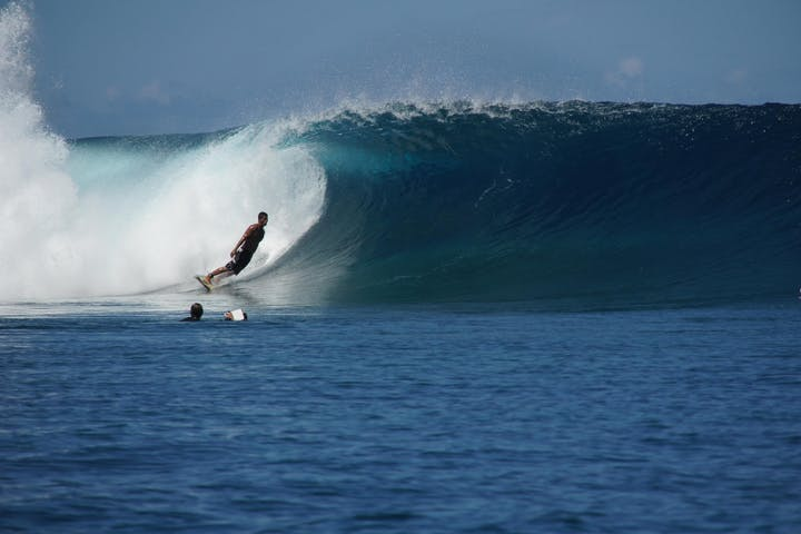 Man surfing in Teahupoo