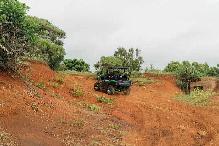 off road vehicle going up dirt road