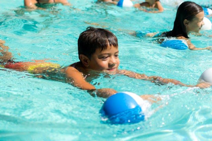 boy taking a swimming class