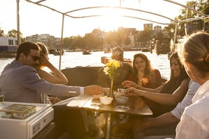 Perfect for your romantic getaway is taking a boat cruise by sunset like these couples