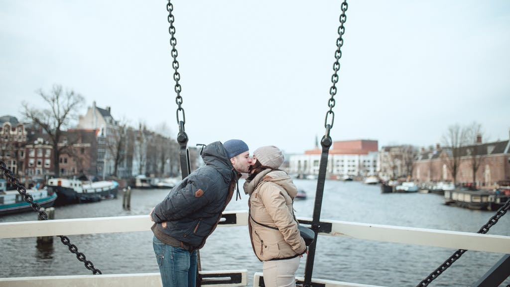 Visit Amsterdam with your couple and kiss on the Skinny bridge.