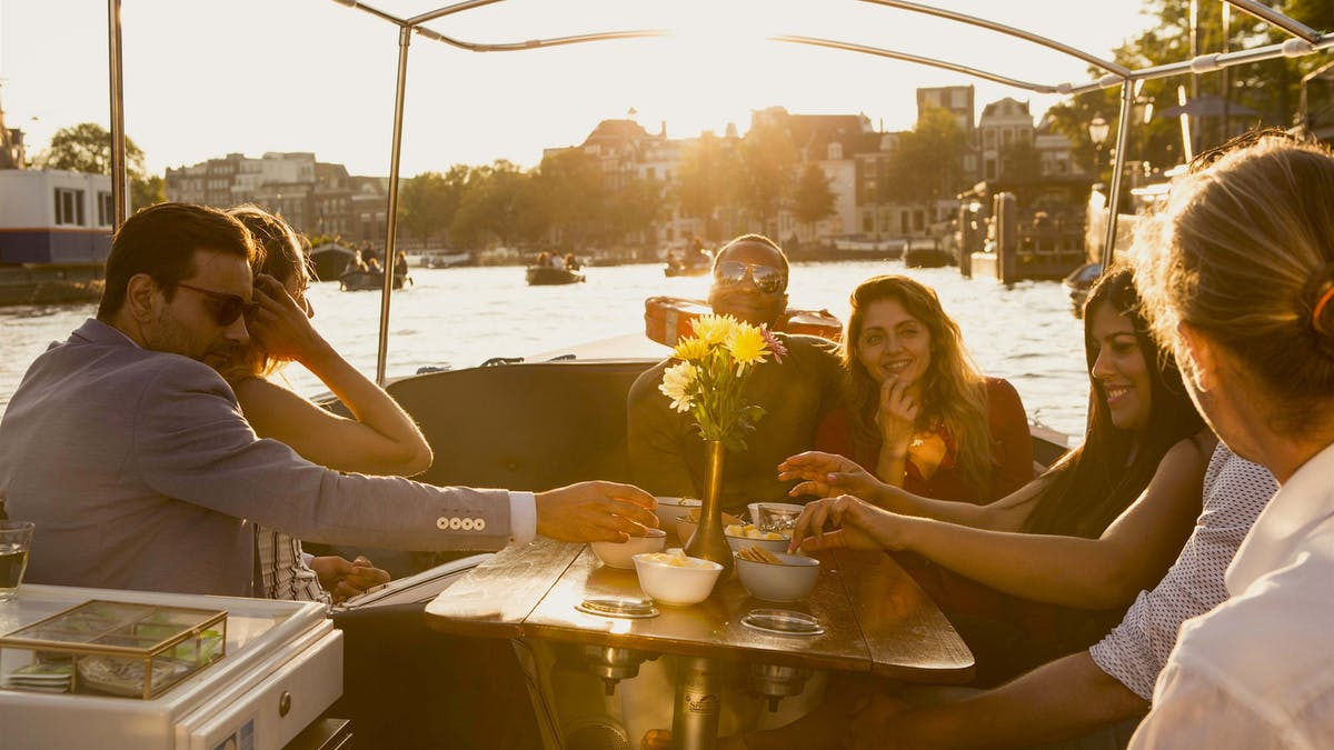 Romantic tour on canals of Amsterdam with couple