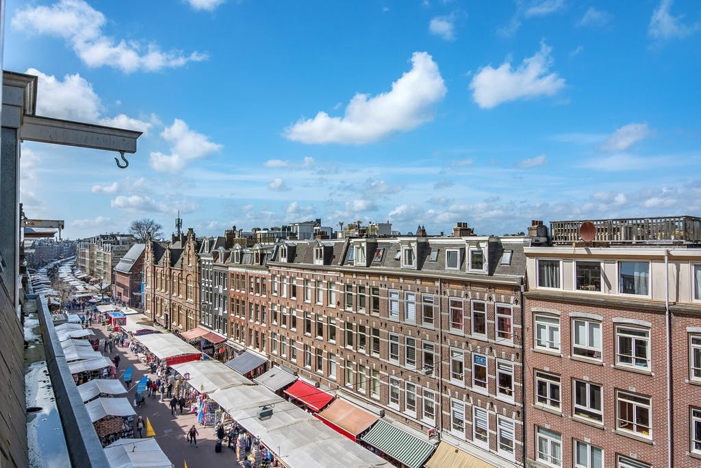 Top view of the Albert Cuypmarket whicthis a must visti during your Romantic trip to Amsterdam