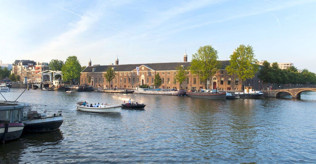 Visit Amsterdam visit the Hermitage a view from the the site of the Amstel river during your Romantic trip to Amsterdam