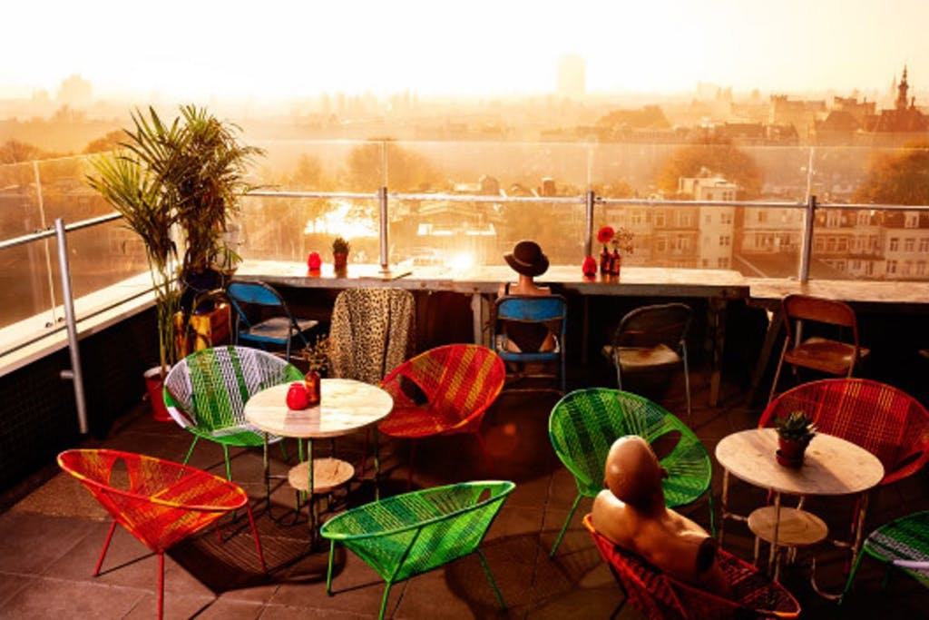 The terras of Club Canvas with awonderful view during your Romantic trip to Amsterdam