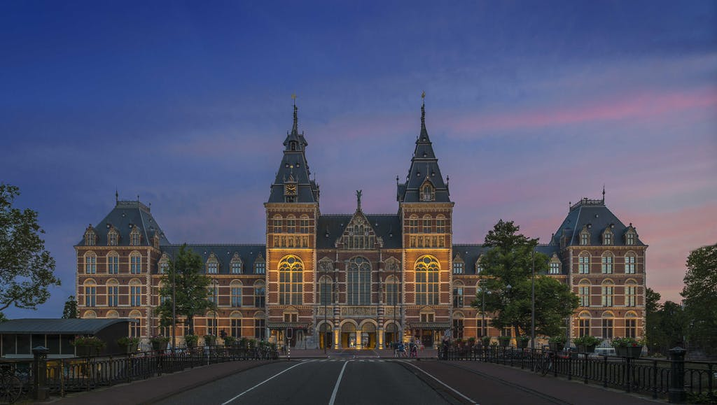 Rijskmuseem at sunset a stunning building during your romantic trip to amsterdam