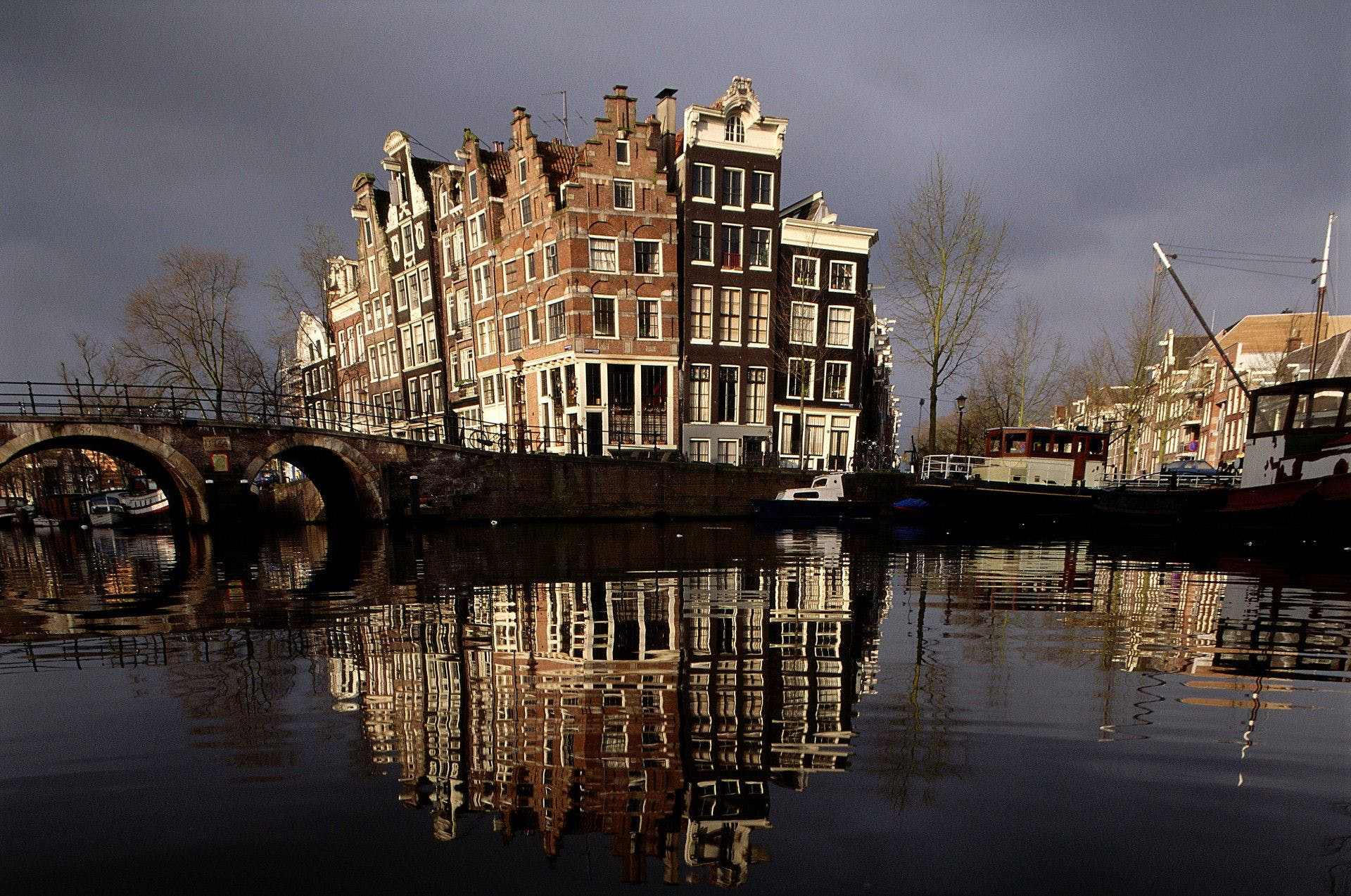 Historic houses on canal corner in Amsterdam