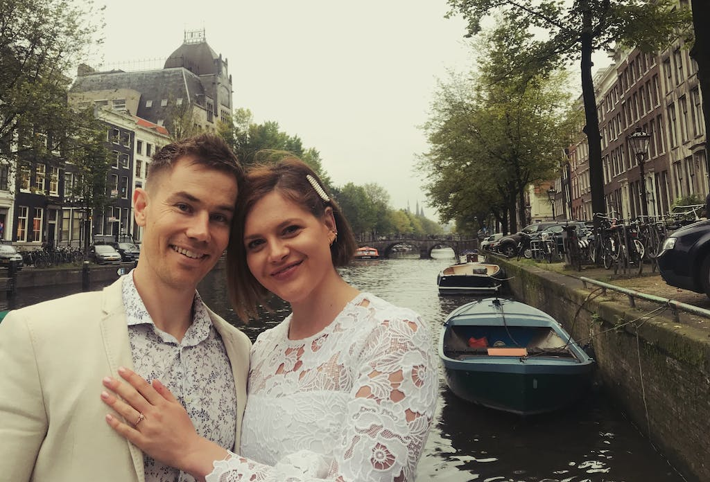 Couple after the Romantic Marriage proposal Canal tour in Amsterdam