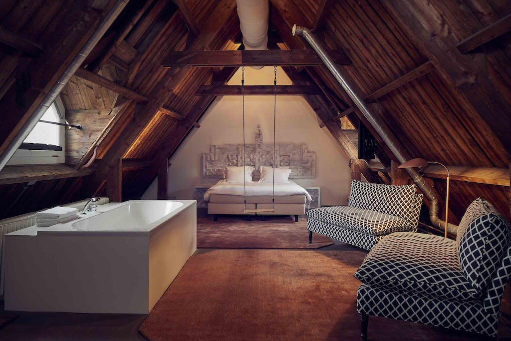 a room with a wooden table one of the romantic hotels in Amsterdam for your proposal