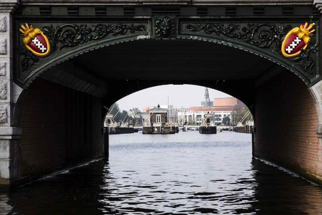 a bridge over a body of water romantic hotels in Amsterdam for your proposal
