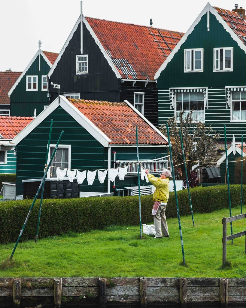 Marken woman hanging wash out