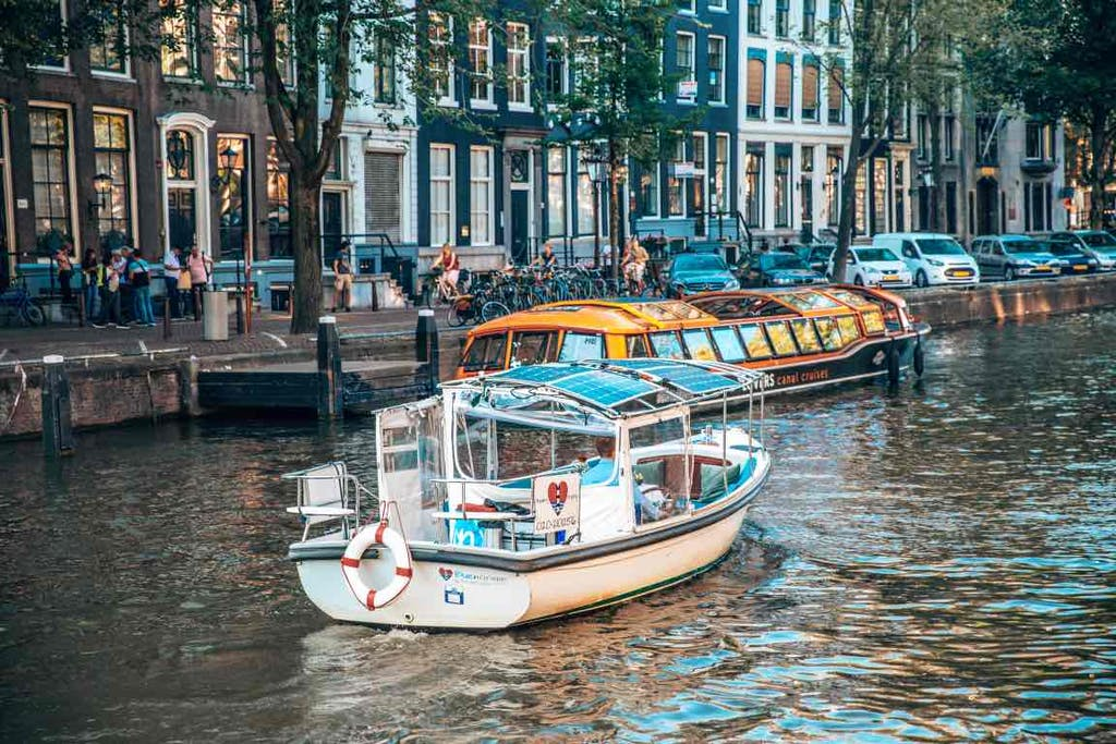small boat on the canal amsterdam romantic
