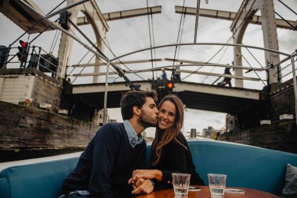 kissing under skinny bridge in Amsterdam