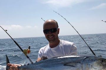 man holding fish he caught