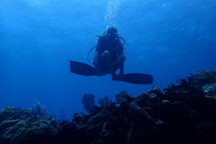 Diver sitting cross legged