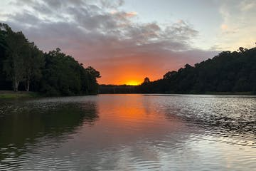 a sunset over a body of water