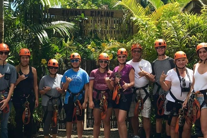 Group photo at jungle zipline with everyone giving the Shaka