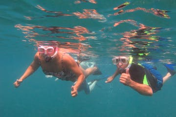 People snorkeling in blue waters