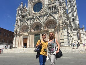 a person standing in front of Siena Cathedral