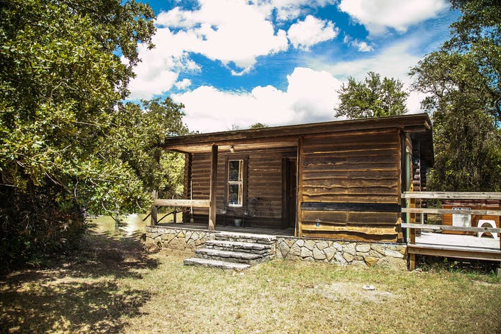Log Cabin with Stone Foundation and Deck and Hot Tub