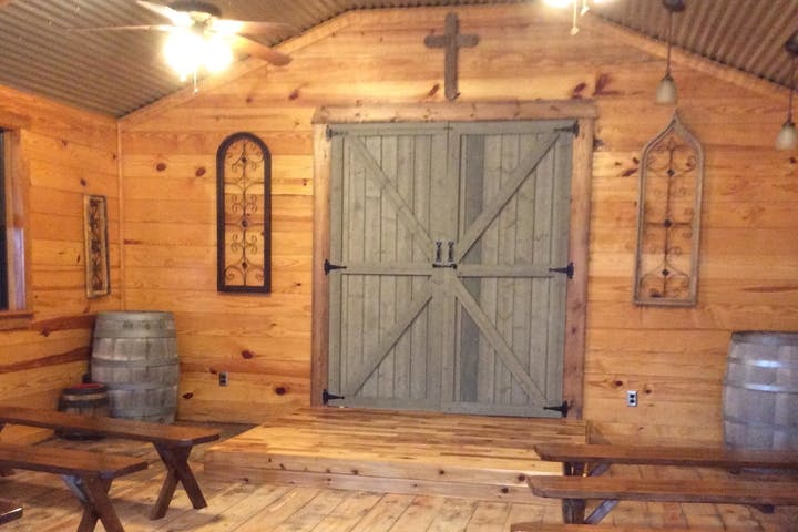 Rustic Wooden Wedding Chapel with Wooden Benches and Barrels