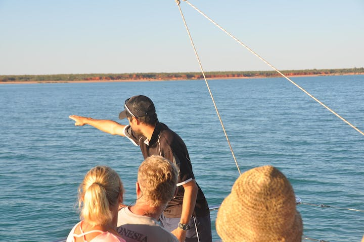 bart pigram pointing across ocean
