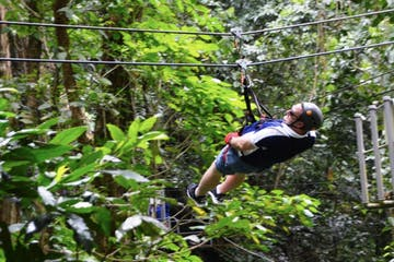 Man ziplining through a forest in Puerto Rico