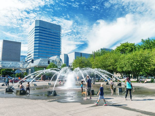 Tourists visit city center. Portland attacts 3 million people annually.