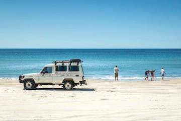 a truck on a sandy beach