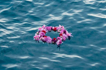 Wreath of flowers floating on the ocean for burial at sea