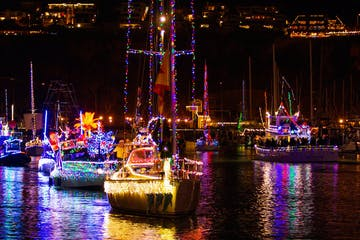 Decorated boats light up Dana Point Harbor during annual Boat Parade