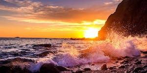 Sun sets behind Dana Point headland and ocean (© Mirecca | Dreamstime)