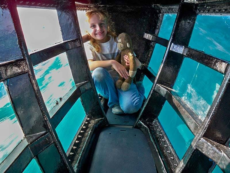 A child in newly opened underwater viewing pod