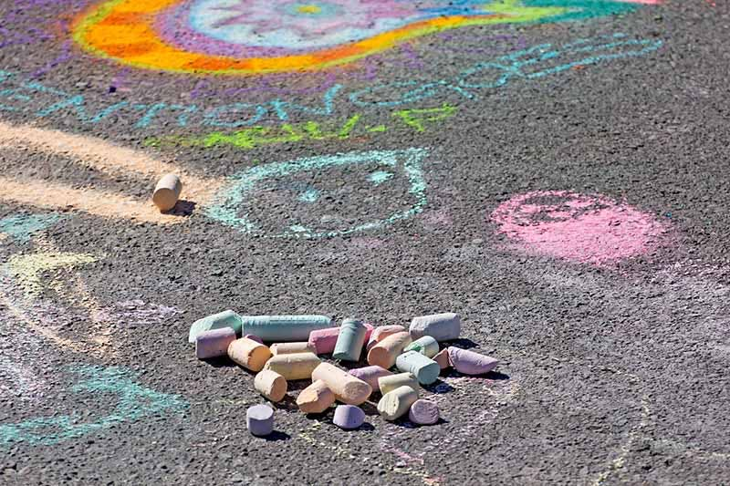 Colored chalk and drawings on a sidewalk
