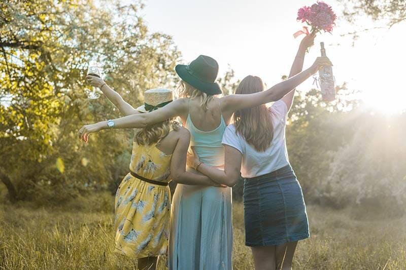 Three women having fun outdoors